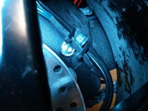 Routing along brake hose